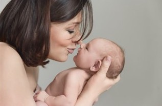 mother holding newborn child, highly successful IVF and fertility treatments